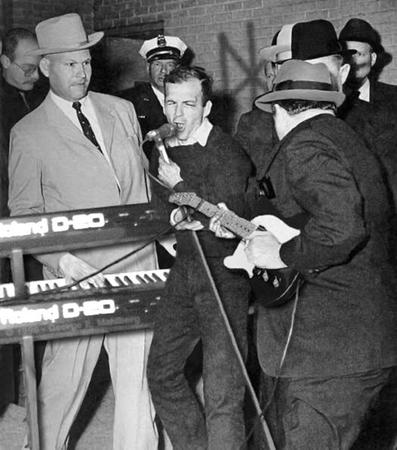 bw guitar hat humor jack_ruby necktie oswald shoop suit // 524x594 // 102.2KB